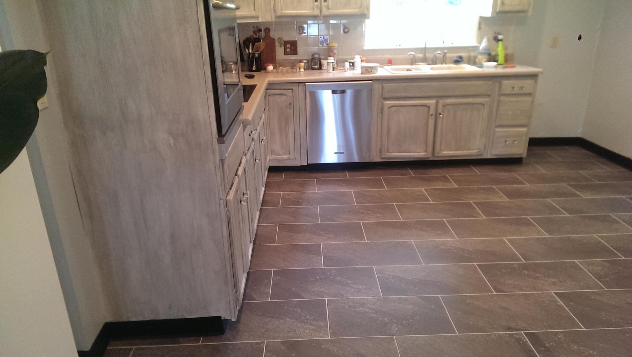 Ultra ceramic vinyl tile toma fine floors for Groutable vinyl tile in bathroom